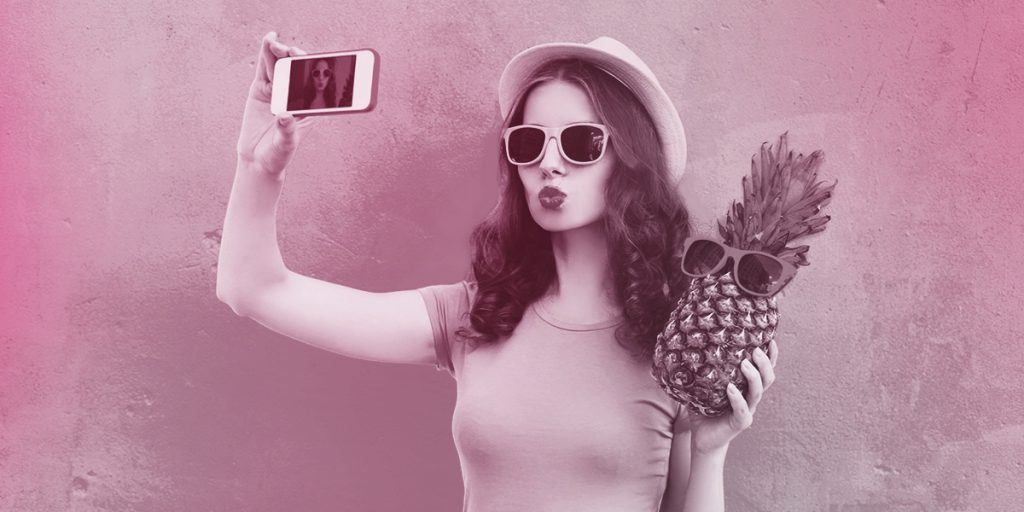 Woman taking selfie with pineapple and sunglasses (Branding and Packaging)