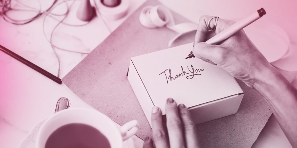 Hand writing 'Thank you' on a package (Branding and Packaging)
