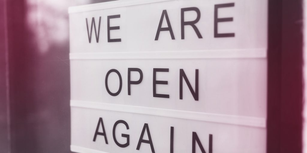 'We are open again' light-box sign on shop window (hospitality consultancy)